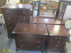 A Stag mahogany bedroom suite consisting of a dressing table and three chests of drawers