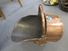 An early 20th century copper coal bucket