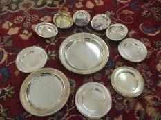 Eleven white metal dishes stamped 833 in various sizes, weight 559.1g
