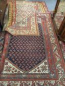 A Kelim rug having a terracotta ground with diamond and geometric design, 167cm x 185cm together