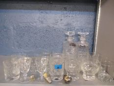A pair of Waterford crystal sherry glasses, pattern unknown, together with two decanters, mixed