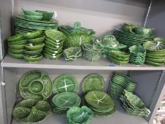 A quantity of Portuguese Cabbage ware, matched, to include eighteen dinner plates, two tureens, jugs