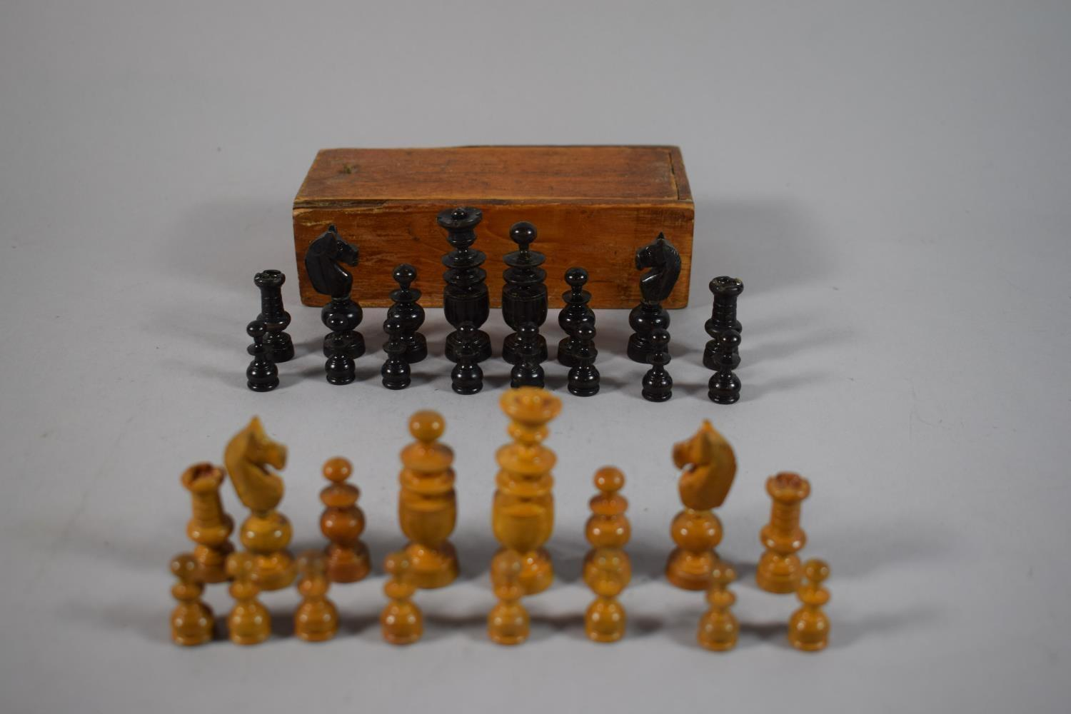 Lot 9 - A Small Wooden Chess Set in Box, King 5.5cms, Complete