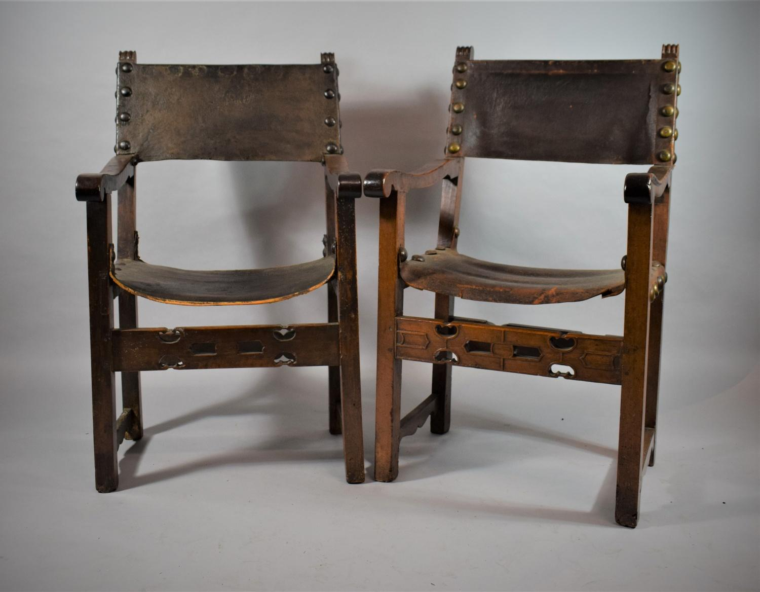 Lot 24 - A Near Pair of 18th Century Spanish Armchairs with Pierced Front Rails, Leather Sling Backs and