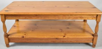 A Rectangular Two Tier Pine Coffee Table with Turned Supports, 106cm wide