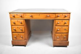 A Late 19th Century Mahogany Kneehole Desk Having Tooled Leather Top, Centre Drawer and Two Banks of