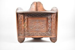 An Edwardian Wall Mounting Galleried Corner Cabinet with Carved Door, 34cm wide and 42cm high