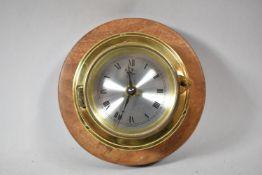 A Modern Brass Circular Miniature Ships Clock Mounted on Wooden Surround, 17.5cm Diameter
