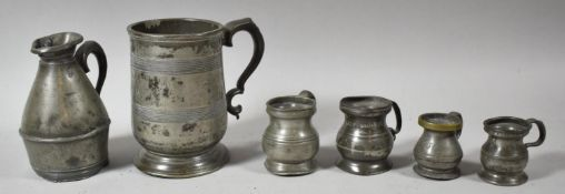 A Collection of Georgian, Victorian and Later Pewter Measures and a Tankard