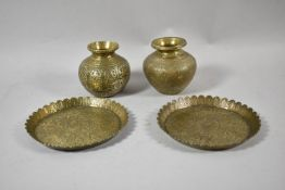 Two Indian Brass Vases and Pair of Lotus Bordered Circular Dishes Decorated with Ganesha and Other