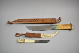 A Finnish Sami Knife Having Tooled Leather Inscribed J Marttiini, Made in Finland Together with a