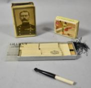 A Kitchener of Khartoum Roll of Honour Match Box Holder Together with a Spanish Bullfighter Box of