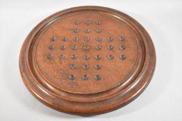 A Large Victorian Circular Mahogany Solitaire Board, 41.5cm Diameter