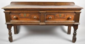 A Cut Down 19th Century Two Drawer Buffet with Galleried Top, Fielded Drawer Fronts and Turned