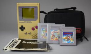 A Vintage Nintendo Gameboy with Super Mario Land II and Disney Tail Spins Games