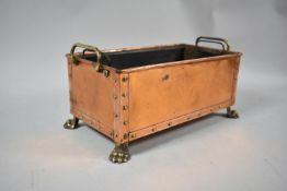 A Rectangular Copper Planting Trough with Brass Handles and Four Claw Feet, Inner Liner 25.5cm Wide