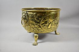 A 19th Century Circular Brass Bowl on Three Claw Feet with Lion Mask and Ring Handles Decorated in