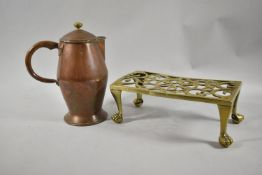 A Late 19th Century Pierced Brass Rectangular Trivet with Claw Feet Together with a Copper Arts