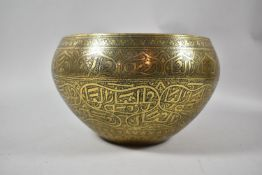 An Indian Brass Circular Bowl with Islamic Engraved Decoration, 28cm Diameter