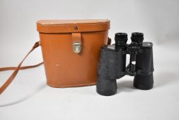 A Pair of Leather Cased King Binoculars, 12x50
