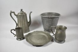 A Collection of Various 19th Century Pewter Items to Include Coffee Pot, Two Tankards, Planter and