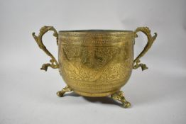 An Indian Brass Circular Bowl with Engraved Decoration to Body, Two Lion Mask Handles and Three