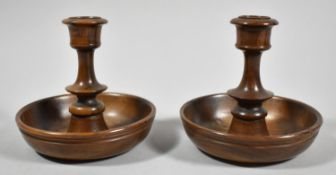 A Pair of Olive Wood Brighton Bun Travelling Candlesticks