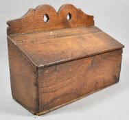 An Early 19th Century Oak Candle Box with Shaped Pierced Crest and Hinged Sloping Lid, 36cm wide