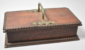 An Edwardian Oak Twin Cigarette Box with Silver Plated Carrying Handle and Gadrooned Borders, 25cm