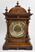 A Late 19th Century Oak Cased Bracket Type Clock with Pierced Brass Mounts and Spandrels, 46cm wide