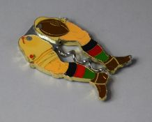 An Enamelled Metal Novelty Corkscrew in the Form of Rugby Player Legs, 9cm high