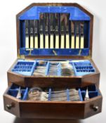 An Edwardian Canteen of Silver Plated and Bone Handled Cutlery in Fitted Top Section and Drawer,