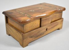 An Inlaid Italian Olivewood Musical Jewellery Box, the Hinged Lid Decorated with Floral Banding
