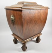 A 19th Century Faux Rosewood Wine Cooler of Sarcophagus Form on Claw and Ball Feet, Hinged Lid and