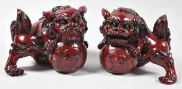 A Pair of Chinese Resin Temple Lions with Front Paws Guarding Flaming Pearls, Each 15cm Wide