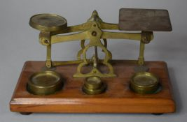 A Set of Desk Top Brass Postage Scales on Wooden Plinth, 17.5cm wide
