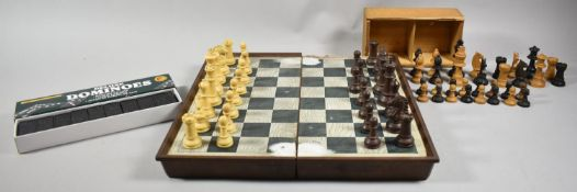 A Folding Plastic Chessboard and Piece Set, a Box Wood Small Set of Chess Pieces and a Cased Set