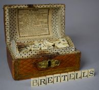 A 19th Century Dome Topped Box in the Form of a Travelling Trunk Containing Bone Alphabetical and