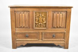 A Mid 20th Century Panelled Oak Lift Top Linenfold Coffer with Armorial Panel and Two Base Drawers
