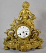 A French Gilt Figural Mantle Clock with Barrel Movement and Seated Cherub Reading Book, 31cm high