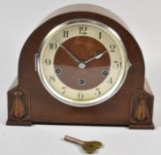 A Mid 20th Century Oak Westminster Chime Mantle Clock with Key and Pendulum