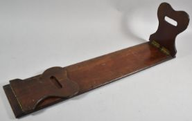 A 19th Century Mahogany Book Rest with Hinged End Panels Having Pierced Carrying Handles, 17cm long