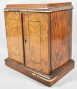 A 19th Century Burr Walnut Four Drawer Collectors Cabinet with Inlaid Hinged Doors and Plinth