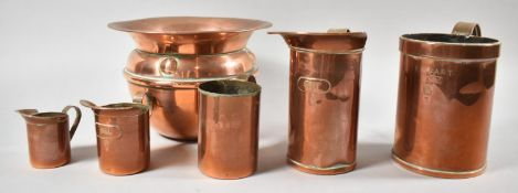 A Copper Planter and Set of Five Copper Measuring Jugs
