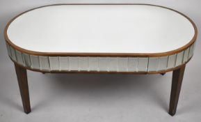 A Modern Mirrored Oval Coffee Table on Square Tapering Legs, 109cm wide