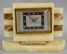 A French Art Deco Alarm Clock with Banded Decoration, Plinth Base 21.5cm wide