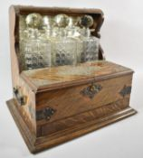 A Late 19th Century Silver Plate Mounted Three Bottle Games Tantalus with Hinged Lid to Games