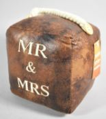 "A New and Unused Leather Door Stop Inscribed ""Mr & Mrs"", 16cm Cube"