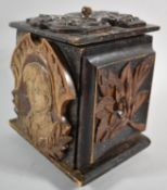 A Continental Carved and Stained Black Forest Box Decorated with Panels Depicting Leaves, Birds,