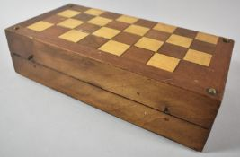 A Late 19th/Early 20th Century Inlaid Walnut Games Box with Chessboard Outer and Paper Backgammon